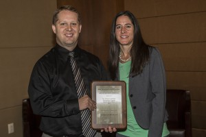 Dr. Jeffrey Wight accepts the New Dentist Committee Outstanding Program Award of Excellence on behalf of The Arizona Dental Association Subcommittee on the New Dentist. Dr. Jennifer Enos is shown presenting the award to Dr. Wight.