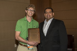 Dr. Michael Auld accepts the Outstanding New Dentist Committee Award on behalf of the Oklahoma Dental Association New Dentist Committee. Dr. Michael LeBlanc is shown presenting the award to Dr. Auld.