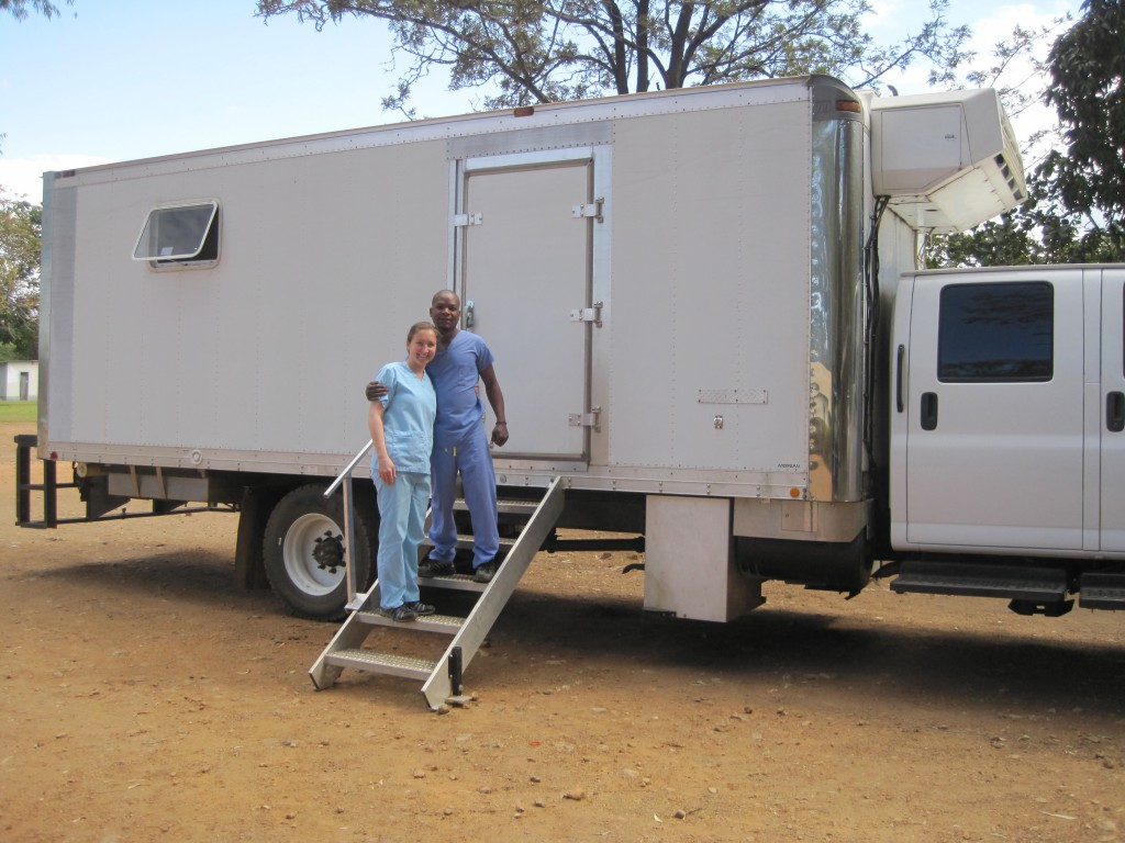 Dr. Hymes and her dental assistant Lucas pose with the International Caring Hands' mobile dental clinic.