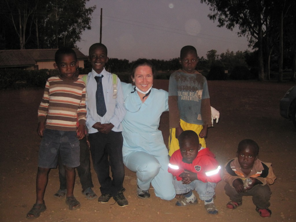 Dr. Rachel Hymes poses with a group of children from Kafue, Zambia where she treated residents through International Caring Hands.