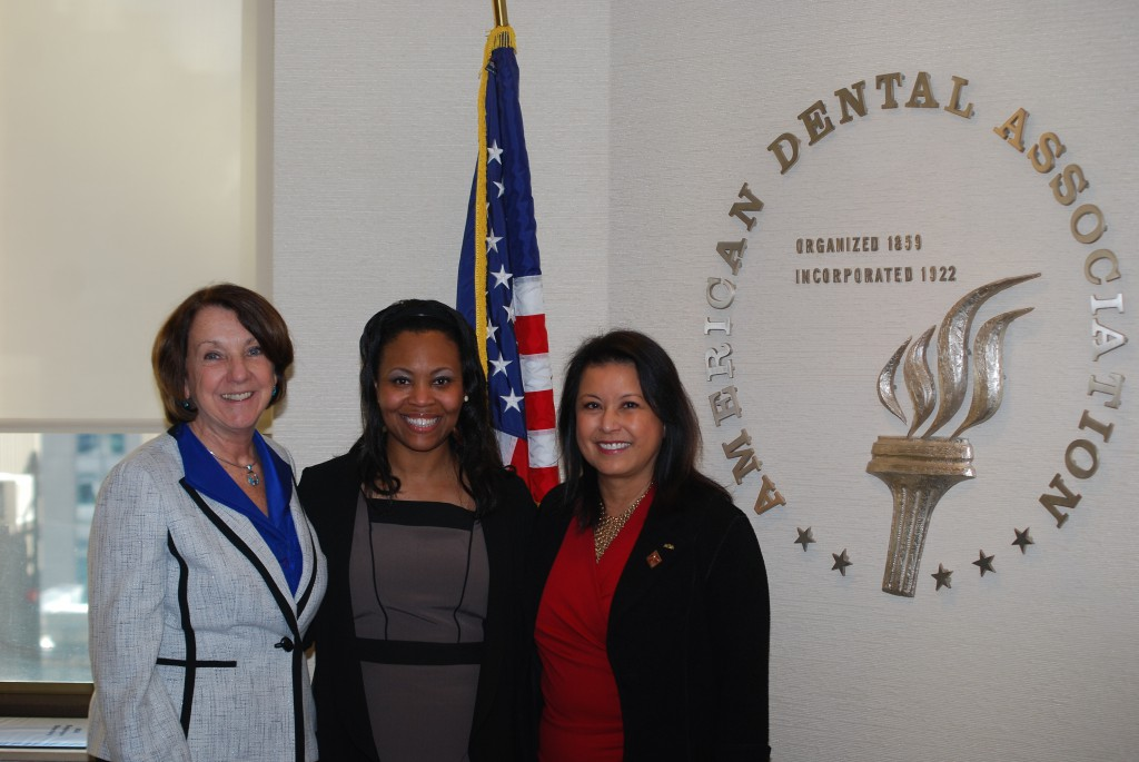 Dr. Christina Rosenthal (center) poses with Dr. Kathleen O'Loughlin (left) and Dr. Carol Gomez Summerhays (right) for a photo at the ADA Headquarters boardroom. Dr. Rosenthal, the 2014-15 Joseph L. Henry Health Fellow in Minority Health Policy at Harvard University, shadowed Dr. O'Loughlin for about three days, including attending the President-Elect's Conference hosted by Dr. Summerhays at ADA Headquarters.