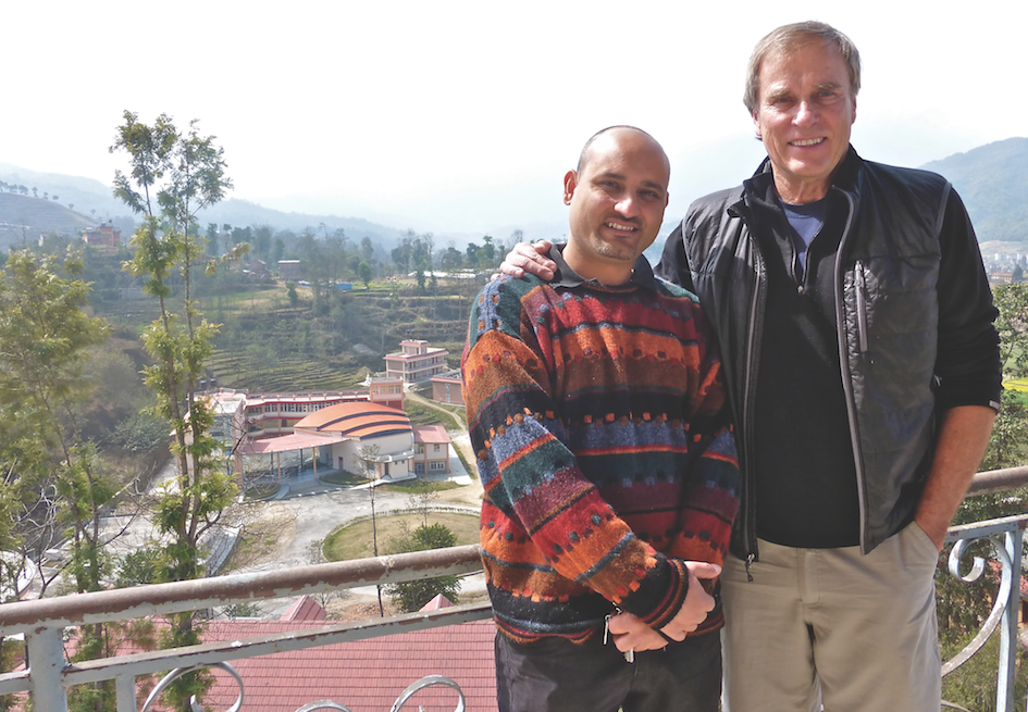 Dr. Dashrath Kafle, left, and Dr. Hollander stand overlooking the dental school at Dhulikhel Hospital. Dr. Kafle is a professor at the school and the HVO project's local contact.