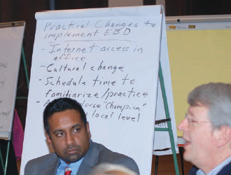 Dr. Partha Mukherji of Forth Worth, Texas (middle), launched a private practice in 2012. Here he participates in a table breakout session at the 2012 ADA Evidence-Based Dentistry Champions Conference in Chicago.