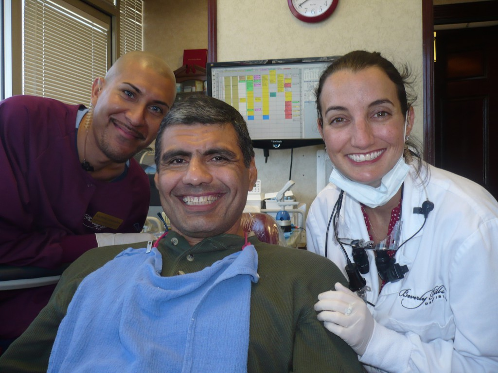 Smile: Dr. Michelle Frawley (right) smile for the a camera with her dental assistant and patient during last year's Veterans' Smile Day event in Beverly Hills, Calif. Dr. Frawley was among 80 dentists from 50 offices around the country to provide free dental care to veterans during the annual event.