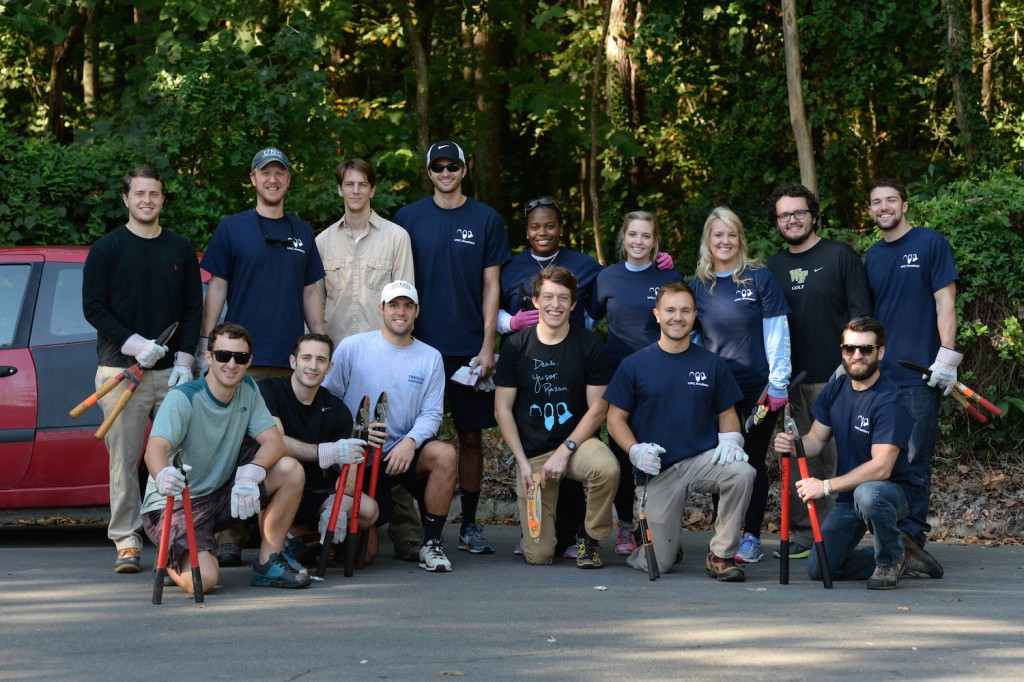 Community service: A group of University of North Carolina dental students pose for a photo after clearing and cleaning Ellerbee Creek as part of DEAH DAY, a day dedicated to community service in honor of the late Deah Barakat, his wife Yusor Abu-Salha and his sister-in-law Razan Abu-Salha.