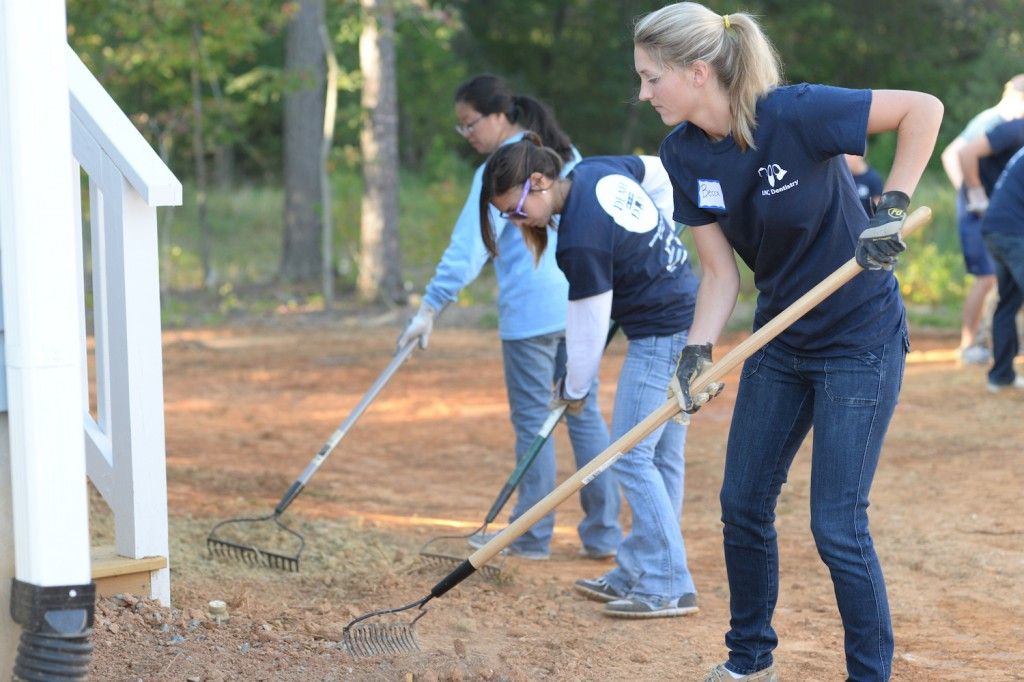 Building homes: University of North Carolina dental students volunteer Sept. 16 with the Habitat for Humanity in Efland, N.C., during DEAH DAY.