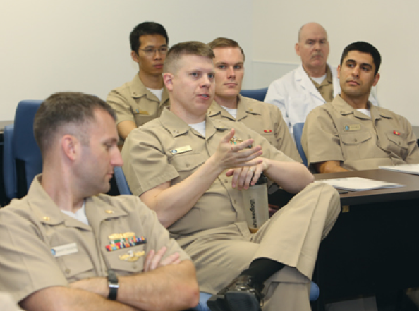 Engaged: A resident at the Naval Postgraduate Dental School engages with ADA leaders during a visit Wednesday.