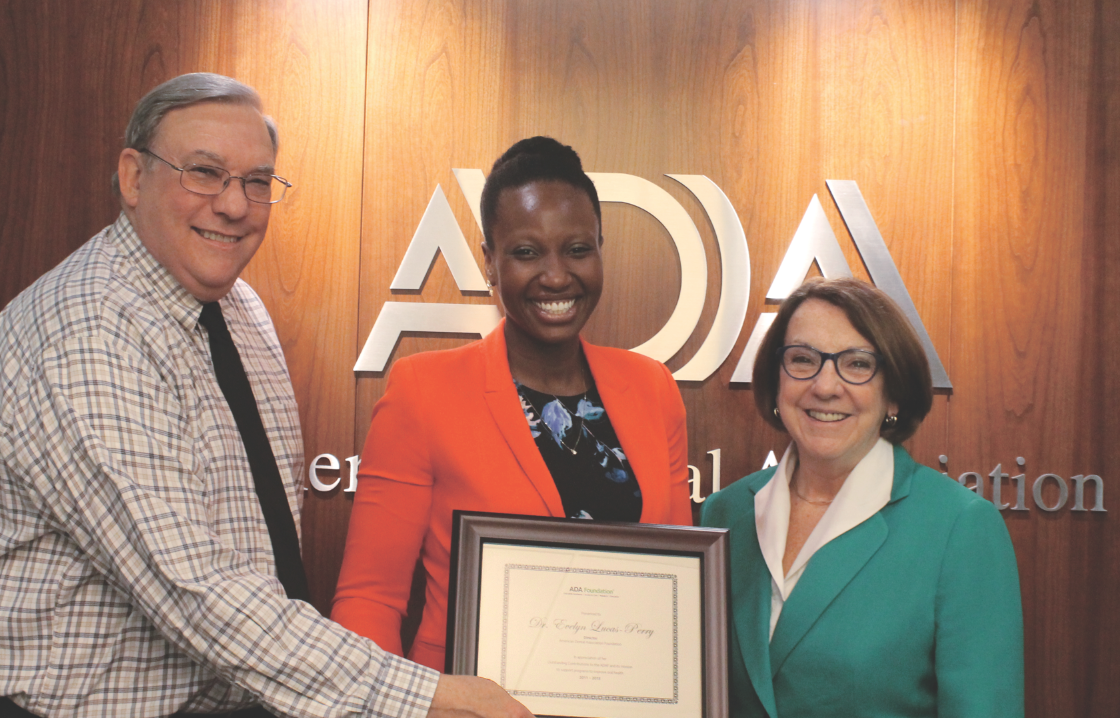 Congratulations: ADA Foundation Executive Director Gene Wurth hands out a Dr. David Whiston Leadership Award to Dr. Evelyn Lucas-Perry in October 2015 while Dr. Kathleen O'Loughlin, ADA executive director, looks on.
