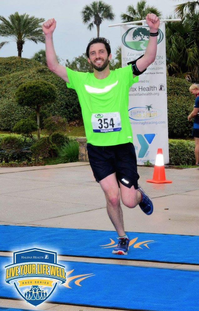 Dr. Drew Byrnes finishes a marathon in March. He said running is one way he mitigates the stress in his life.
