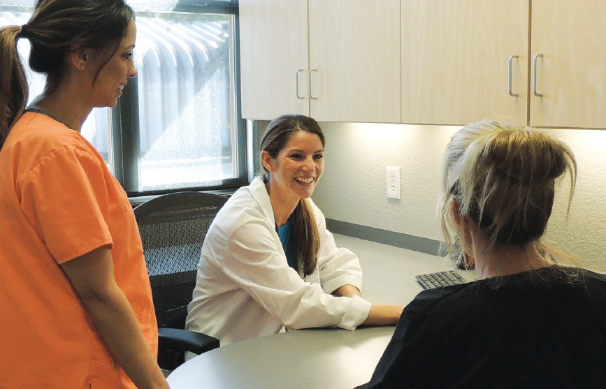 Leadership: Dr. Alexandra Barton Otto convenes a midday huddle with hygienist Jessica Tamez (left) and assistant Kristen Lassetter.